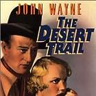 John Wayne and Mary Kornman in The Desert Trail (1935)