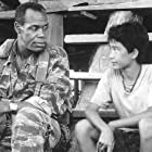 Danny Glover and Dinh Thien Le in Operation Dumbo Drop (1995)