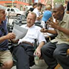 Bruce Willis, Richard Donner, and Yasiin Bey in 16 Blocks (2006)