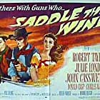 John Cassavetes, Robert Taylor, and Julie London in Saddle the Wind (1958)