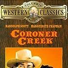 Randolph Scott and Marguerite Chapman in Coroner Creek (1948)
