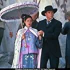 Princess Pei Pei is guided through a quarry by her English tutor, Andrews