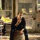 Greg Kinnear as Simon
