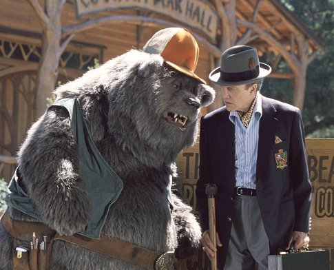Big Al (left), longtime caretaker of Country Bear Hall, gives the lowdown to Reed Thimple (Christopher Walken, right), an evil banker determined to destroy the legendary venue.