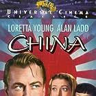 Alan Ladd, Iris Wong, and Loretta Young in China (1943)