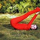 """33-2275 Audrey Hepburn doing exercises on the MGM set of """"Green Mansions"""""""