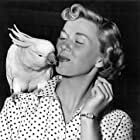 """Doris Day On the Set of """"Young Man With a Horn"""" With Louise, a cockatoo 1950"""