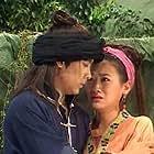 Jimmy Lin and Joanne Lien in Jue dai shuang jiao (1999)