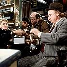 Sean Penn, Donald Sutherland, Wallace Shawn, Trinidad Silva, and Jack Warden in Crackers (1984)