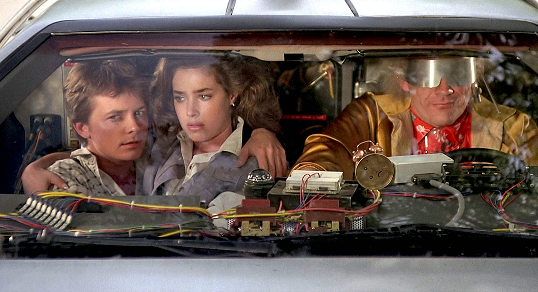 Michael J. Fox, Christopher Lloyd, and Claudia Wells in Back to the Future (1985)