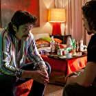 Benicio Del Toro and Aaron Taylor-Johnson in Savages (2012)