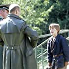 Haley Joel Osment, Eugene Osment, and Krzysztof Pieczynski in Edges of the Lord (2001)