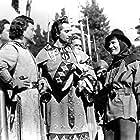 Errol Flynn, Claude Rains, and Basil Rathbone in The Adventures of Robin Hood (1938)