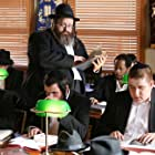 Rabbi Meyer with a watchful eye at the study hall (beis medresh)