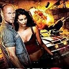 Luke Goss and Tanit Phoenix in Death Race: Inferno (2013)