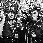 Errol Flynn, Patric Knowles, and Herbert Mundin in The Adventures of Robin Hood (1938)