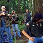 """""""Park Ranger Eagleheart in trouble with the poachers."""" (Michael Bailey Smith, Miles O'Keefe, Cooper Huckabee, Nathaniel Arcand)"""