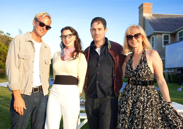 """Daniel Benedict, Ashley Anderson, Zack Galligan and Kathleen Demonchy pose together during The Cinema Society & Dior Beauty screening of """"Grease: Sing-A-Long"""" on July 2, 2010 in Sagaponack, New York."""