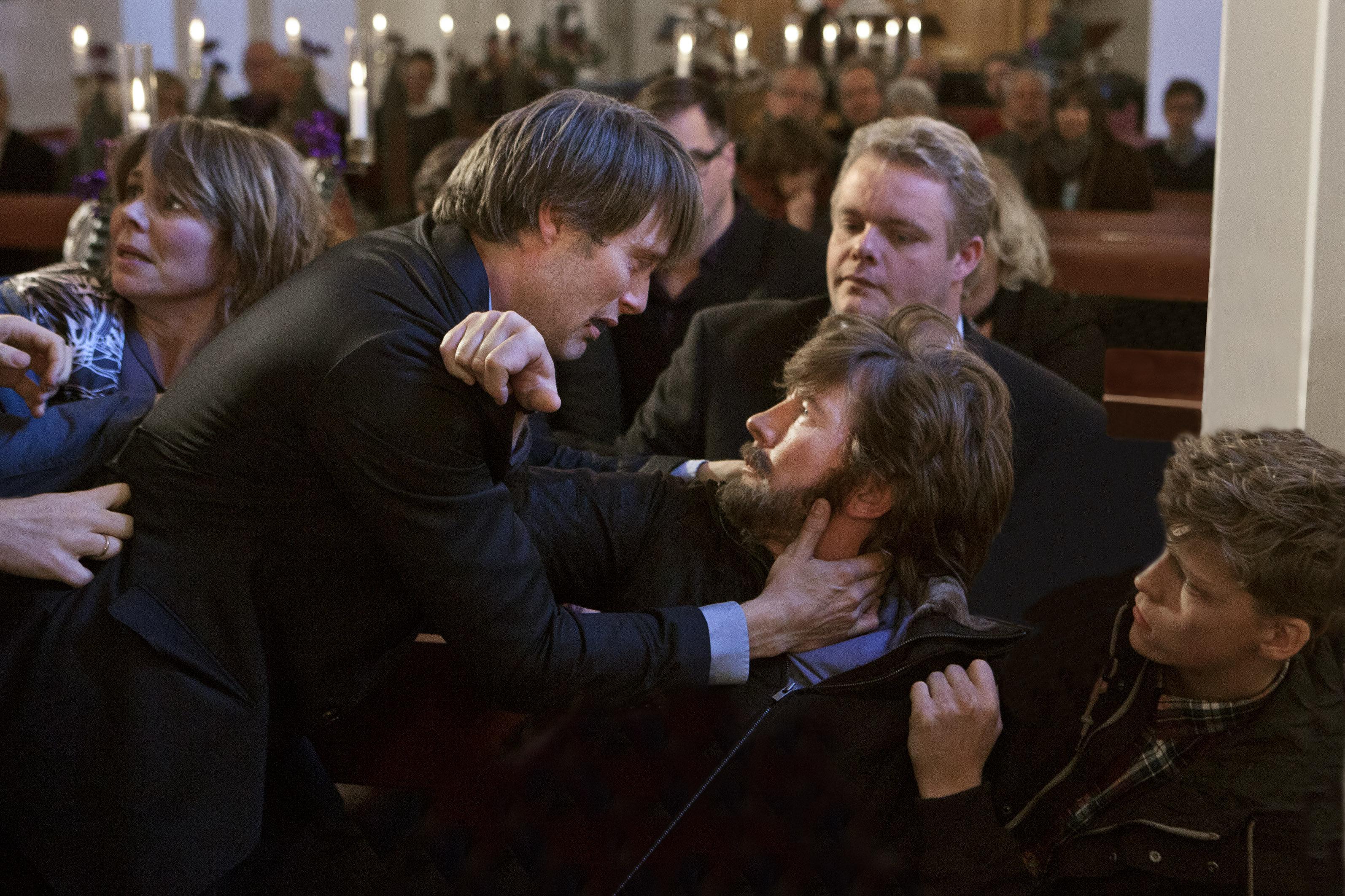 Anne Louise Hassing, Thomas Bo Larsen, Mads Mikkelsen, Daniel Engstrup, and Sebastian Bull Sarning in Jagten (2012)