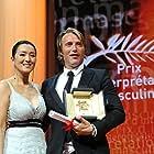 Gong Li and Mads Mikkelsen at an event for Jagten (2012)
