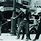 Charles Chaplin, Austen Jewell, and Robert Parrish in City Lights (1931)