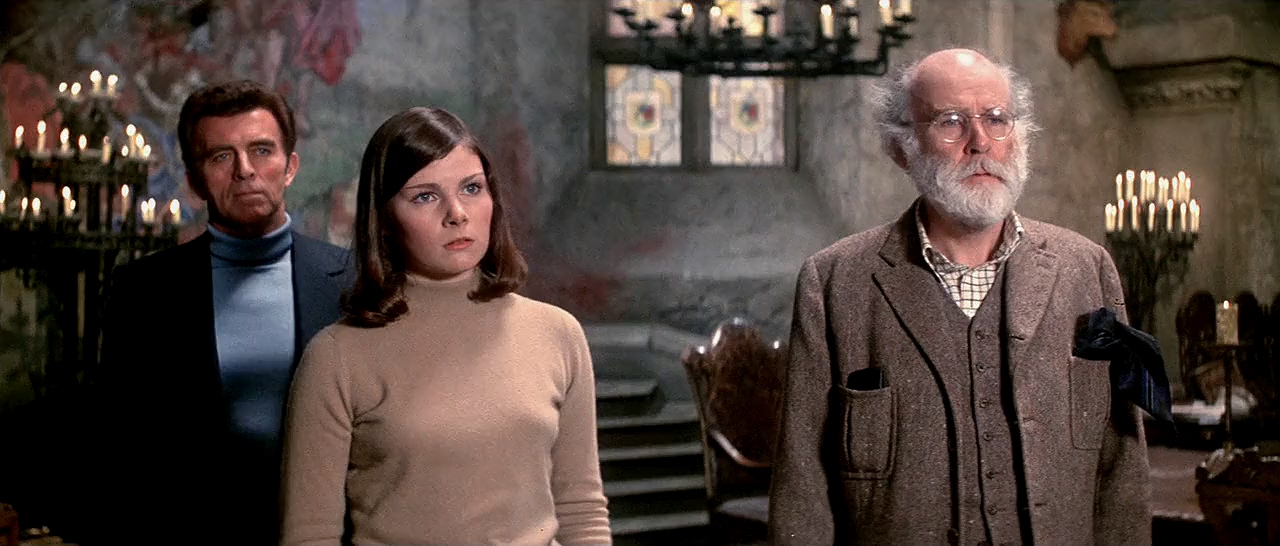 Briony McRoberts, John Sullivan, and Richard Vernon in The Pink Panther Strikes Again (1976)