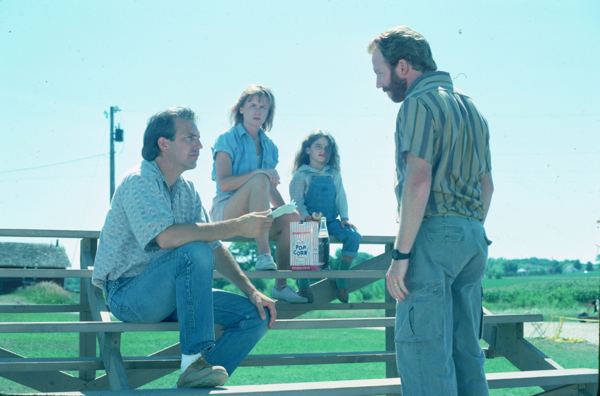 Kevin Costner, Gaby Hoffmann, Amy Madigan, and Timothy Busfield in Field of Dreams (1989)