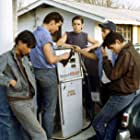 Tom Cruise, Matt Dillon, Rob Lowe, C. Thomas Howell, and Ralph Macchio in The Outsiders (1983)