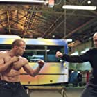 Jason Statham and Jean-Marie Paris in The Transporter (2002)