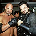 Bill Goldberg (appearing as himself) poses with Oliver Platt (appearing as Jimmy King)