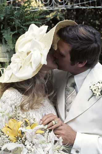 Farrah Fawcett with husband Lee Majors on their wedding day July 28, 1973