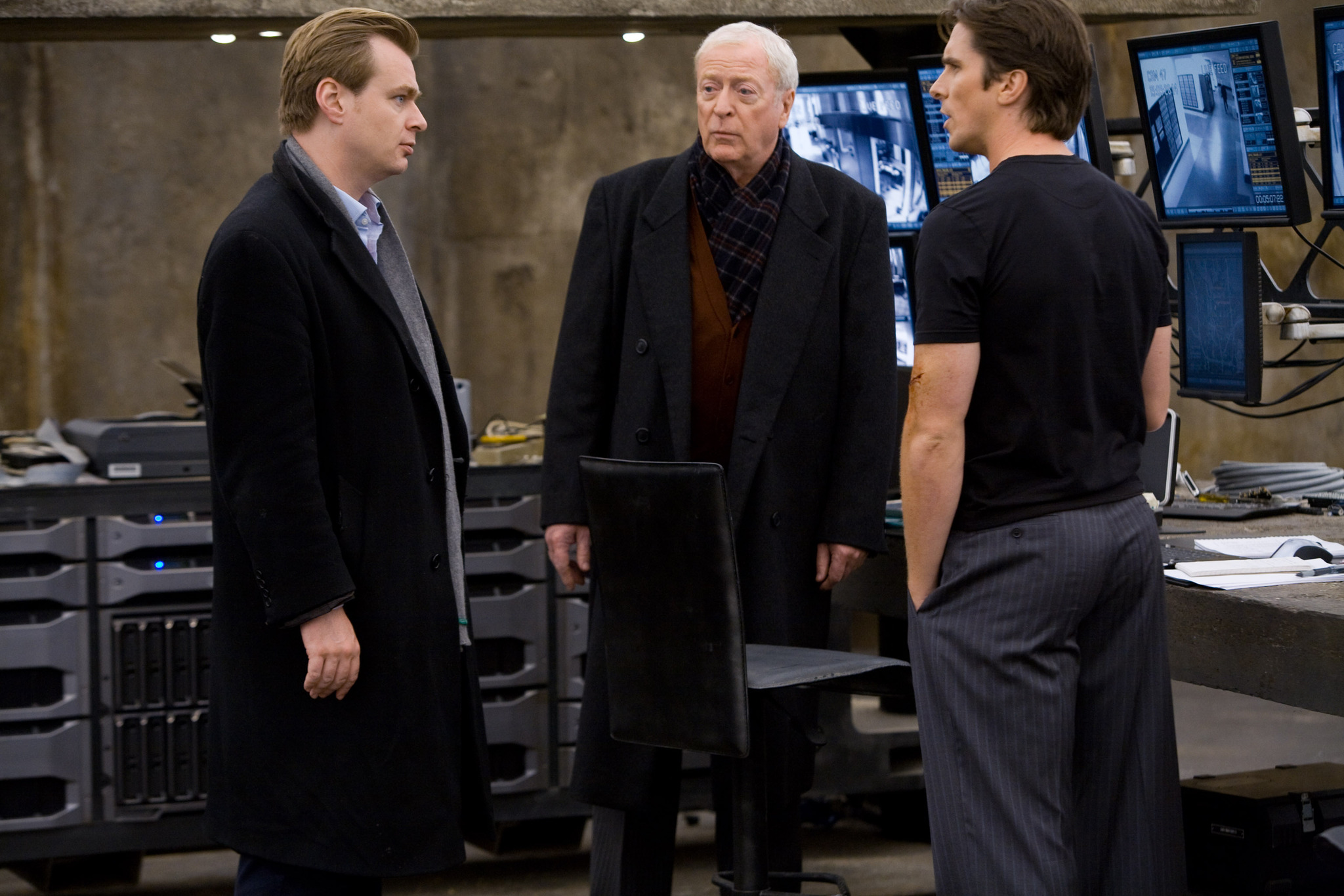 Christian Bale, Michael Caine, and Christopher Nolan in The Dark Knight (2008)