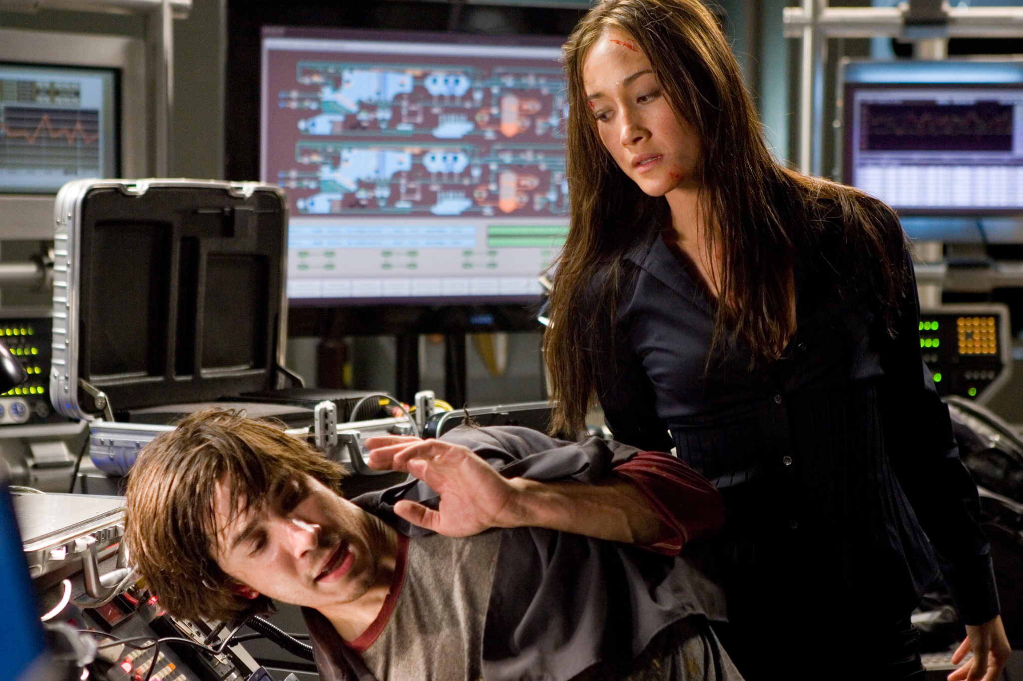 Justin Long and Maggie Q in Live Free or Die Hard (2007)