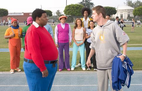 Arthur (J. Mack Slaughter, Jr. right) confronts Fat Albert (Kenan Thompson) on the track.  Observing in the background are (L-R) Mushmouth (Jermaine Williams), Dumb Donald (Marques B. Houston), Rudy (Shedrack Anderson III), Lauri (Dania Ramirez), Old Weird Harold (Aaron A. Frazier), Doris (Kyla Pratt) and Bucky (Alphonso McAuley).