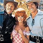 Kirk Douglas, Arnold Schwarzenegger, and Ann-Margret in The Villain (1979)