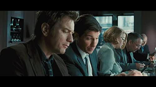 A ghostwriter (McGregor) hired to complete the memoirs of a former British prime minister (Brosnan) uncovers secrets that put his own life in jeopardy.