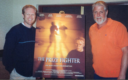 """Jeff Howard (l) and Mark Mason (r) with a poster for their film, """"The Prize Fighter""""."""