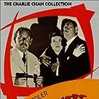 Douglass Dumbrille, Lenita Lane, and Sidney Toler in Castle in the Desert (1942)