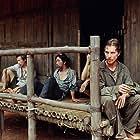 Christian Bale, Jeremy Davies, Steve Zahn, Lek Chaiyan Chunsuttiwat, and Apichart Chusakul in Rescue Dawn (2006)
