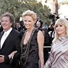 Charlize Theron, Britt Ekland, and Geoffrey Rush at an event for The Life and Death of Peter Sellers (2004)