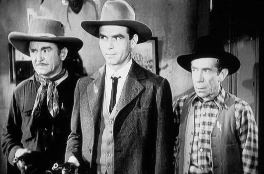 Ernie Adams, Eddie Dew, and Bud Osborne in Riding the Wind (1942)