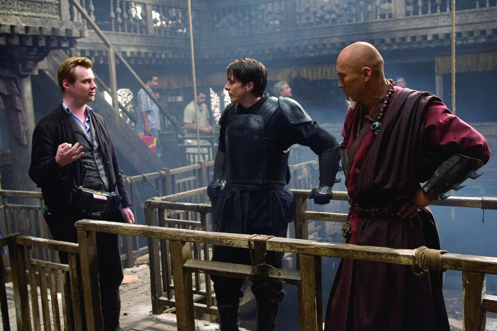 Christian Bale, Christopher Nolan, and Ken Watanabe in Batman Begins (2005)