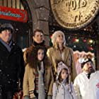 Chris Coppola, John Ducey, Bonnie Somerville, Danny Woodburn, Madison Pettis, and Kaitlyn Maher in The Search for Santa Paws (2010)