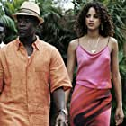 Don Cheadle and Noémie Lenoir in After the Sunset (2004)