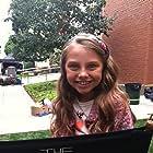 """Caitlin Carmichael as Emma on """"The Neighbors"""" 2012"""