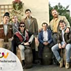 Timothy Spall, Christopher Fairbank, Tim Healy, Gary Holton, Jimmy Nail, Pat Roach, and Kevin Whately in Auf Wiedersehen, Pet (1983)