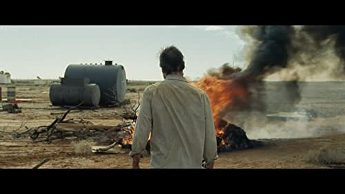 10 years after a global economic collapse, a hardened loner pursues the men who stole his only possession, his car. Along the way, he captures one of the thieves' brother, and the duo form an uneasy bond during the dangerous journey.