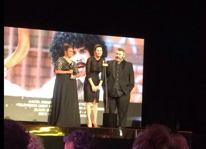 Bec Cole and Craig Anderson accepting the award for Best Director in Television Light Entertainment or Reality for Black Comedy. Joined by writer/performer Elizabeth Wymarra.