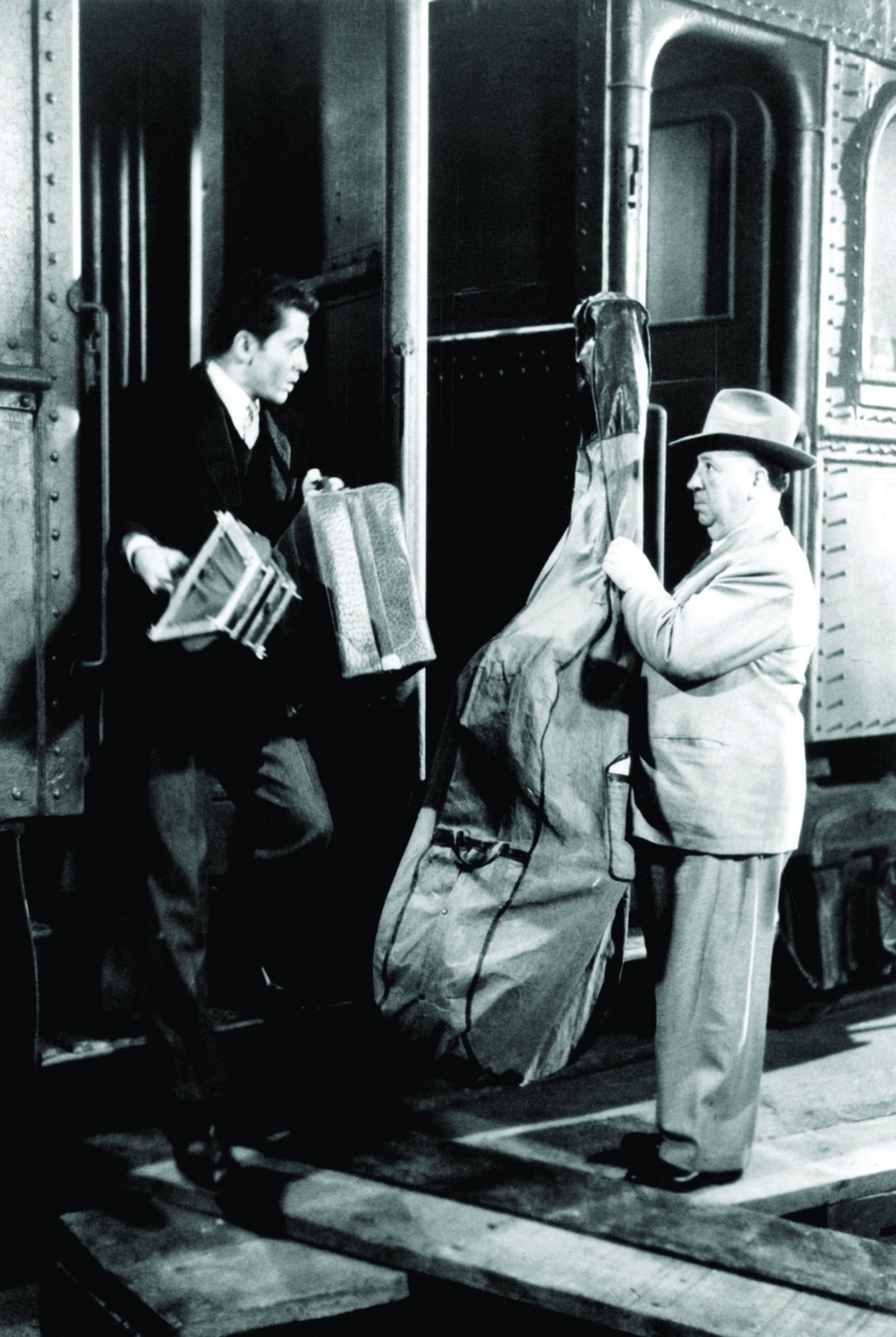 Alfred Hitchcock and Farley Granger in Strangers on a Train (1951)