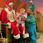 Billy Bob Thornton and Tony Cox in Bad Santa (2003)